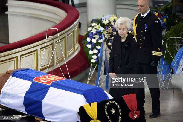 Widow Tellervo Koiviosto pays tribute next to the coffin of Finland's former President Mauno Koivisto during the state funeral ceremony at the...