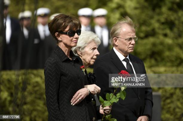 Widow Tellervo Koivisto daughter Assi KoivistoAllonen and her husband Heikki Allonen look on during the burial ceremony of Finland's former President...