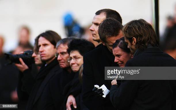 Widow Teresa Enke cries as members of the Hannover 96 football club carry the coffin of their goalie Robert Enke at a memorial service prior to...