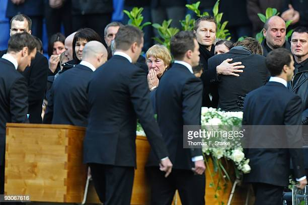 Widow Teresa Enke cries while the coffin of Robert Enke is brought out by players of Hannover 96 during the memorial service prior to Robert Enke's...