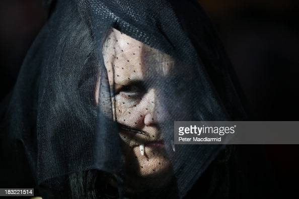 A widow vampire shows her fangs behind a veil at the Shocktober Fest at Tulleys Farm on October 5 2013 near Crawley West Sussex Each October...