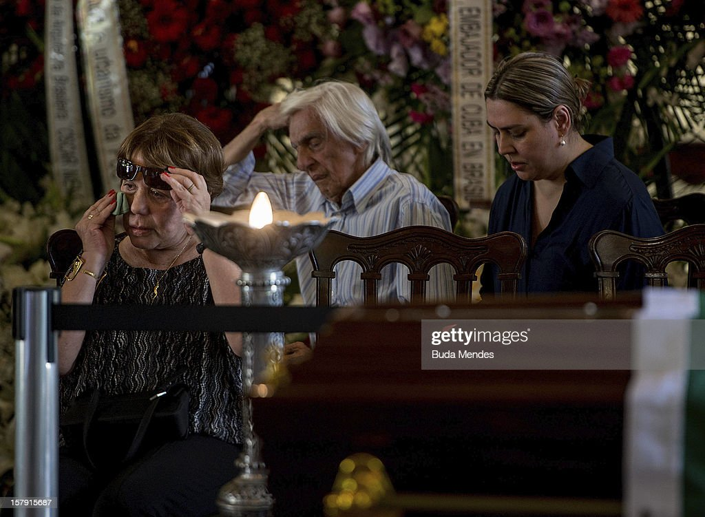 Widow Vera Lœcia Niemeyer cries during the funeral of the Architect Oscar Niemeyer at Palacio City on December 07, 2012 in Rio de Janeiro, Brazil. Niemeyer was hospitalized for 33 days at Samarian Hospital and died at 104 years old due to a kidney infection on December 06, 2012 in Rio de Janeiro, Brazil.