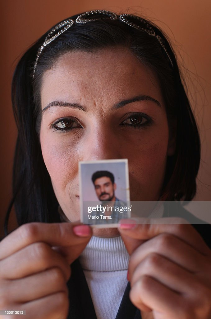 Widow Wafaa Shahab holds a photo of her deceased husband Bassim Muhammed on December 12, 2011 in Baghdad, Iraq. Muhammed was executed by al Qaeda militants in front of his house, forcing Shahab and her three children to flee to Syria and northern Iraq for three years. A study by Relief International concluded that around 10 percent of the approximately 15 million women living in Iraq are widows. A United Nations report estimated that nearly 100 women were widowed daily at the height of the sectarian violence in 2006. Iraq is transitioning nearly nine years after the 2003 U.S. invasion and subsequent occupation. American forces are now in the midst of the final stage of withdrawal from the war-torn country. At least 4,485 U.S. military personnel have died in service in Iraq. According to the Iraq Body Count, more than 100,000 Iraqi civilians have died from war-related violence.