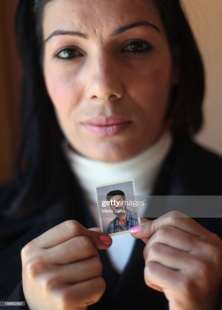 Widow Wafaa Shahab holds a photo of her deceased husband Bassim Muhammed on December 12, 2011 in Baghdad, Iraq. Muhammed Muhammed was said to have been executed by al Qaeda militants in front of his house, forcing Shahab and her three children to flee to Syria and northern Iraq for three years. A study by Relief International concluded that around10 percent of the approximately 15 million women living in Iraq are widows. A United Nations report estimated that nearly 100 women were widowed daily at the height of the sectarian violence in 2006. Iraq is transitioning nearly nine years after the 2003 U.S. invasion and subsequent occupation. American forces are now in the midst of the final stage of withdrawal from the war-torn country. At least 4,485 U.S. military personnel have died in service in Iraq. According to the Iraq Body Count, more than 100,000 Iraqi civilians have died from war-related violence.