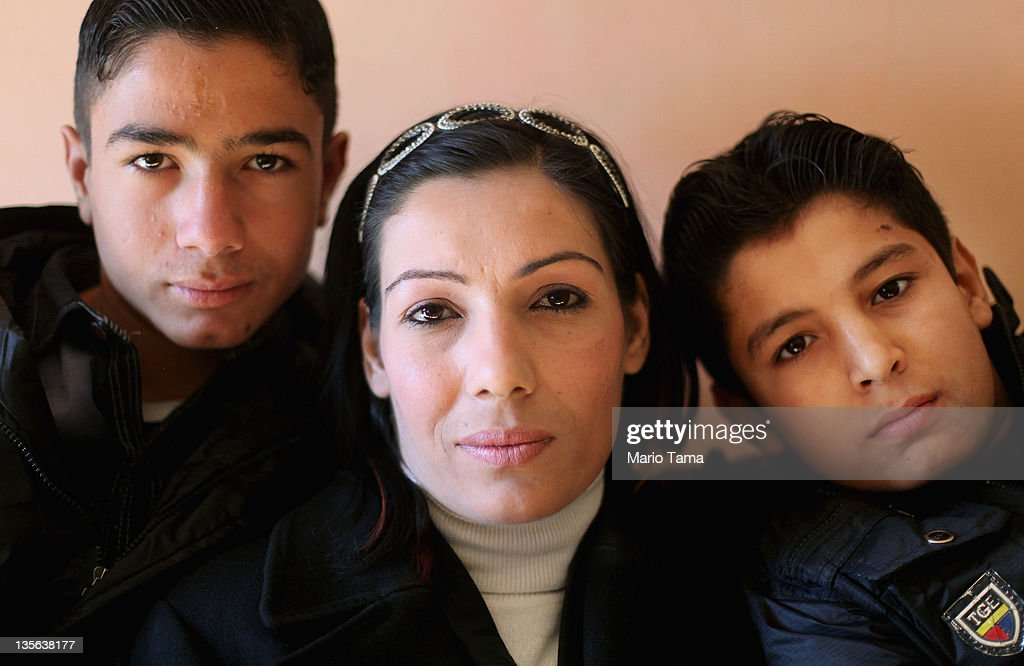 Widow Wafaa Shahab (C) sits with her sons Nooreldin Bassim (L) and Ahmed Bassim (R) on December 12, 2011 in Baghdad, Iraq. Husband and father Bassim Muhammed Muhammed was said to have been executed by al Qaeda militants in front of his house, forcing Shahab and her three children to flee to Syria and northern Iraq for three years. Nooreldin and Ahmed witnessed the killing. A study by Relief International concluded that around 10 percent of the approximately 15 million women living in Iraq are widows. A United Nations report estimated that nearly 100 women were widowed daily at the height of the sectarian violence in 2006. Iraq is transitioning nearly nine years after the 2003 U.S. invasion and subsequent occupation. American forces are now in the midst of the final stage of withdrawal from the war-torn country. At least 4,485 U.S. military personnel have died in service in Iraq. According to the Iraq Body Count, more than 100,000 Iraqi civilians have died from war-related violence.