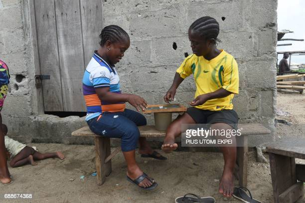 Widows play game to ease tension following an eviction notice served by Lagos State government on residents of IlajeBariga waterfront slum mostly...