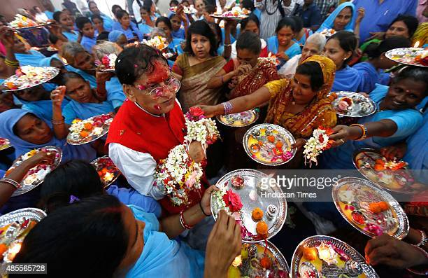 Widows tie Rakhis to Dr Bindeshwar Pathak on the eve of Raksha Bandhan which will be celebrated on August 29 during an event organized at...