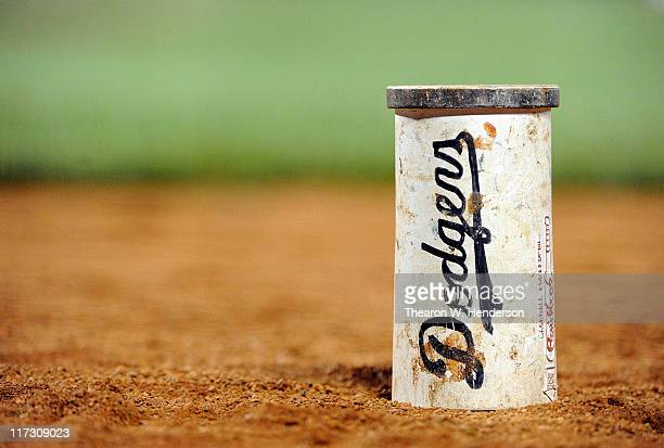 A wieght with the Los Angeles Dodgers logo on it used by the Cleveland Indians sits in the ondeck circle during a MLB baseball against the San...