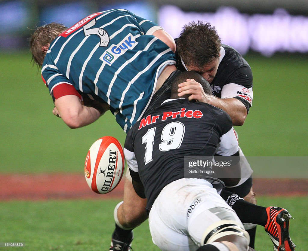Wiehahn Herbst and Lubabalo Tera Mtembu tackle Martin Muller during the Absa Currie Cup match between The Sharks and GWK Griquas at Mr Price KINGS PARK on October 12, 2012 in Durban, South Africa.