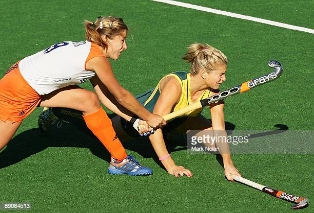 Wieke Dijkstra of the Netherlands and Kate Holywood of Australia clash during the Women's Hockey Champions Trophy match between the Australian...