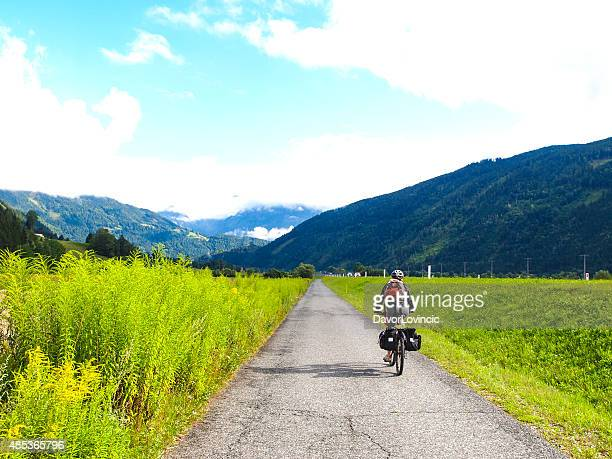 Wiew of drau cycle path with biker near Dellach, Austria
