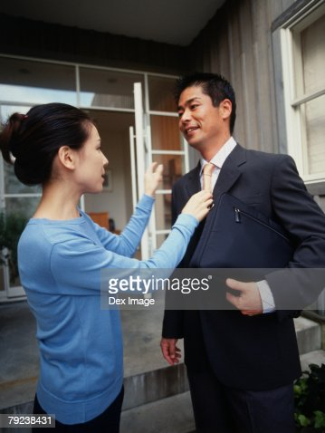 Wife adjusting husband's tie : Stock Photo