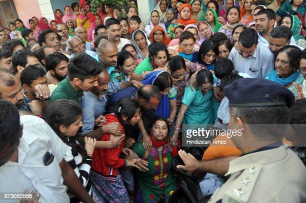 Wife daughters and family members of martyred soldier Sanjay Kumar who lost his life while fighting Maoists in Sukma Chhattisgarh wail near his body...