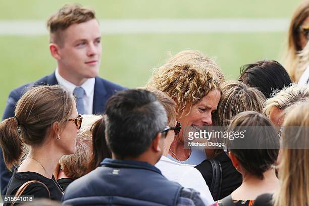 Wife Geraldine Couch is comforted during the memorial service for Paul Couch at Simonds Stadium on March 15 2016 in Geelong Australia Former Geelong...