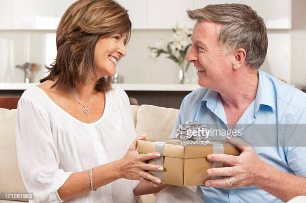 Wife giving her husband a gift