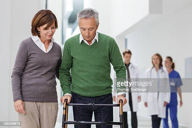 Wife helping with Husband's recover.