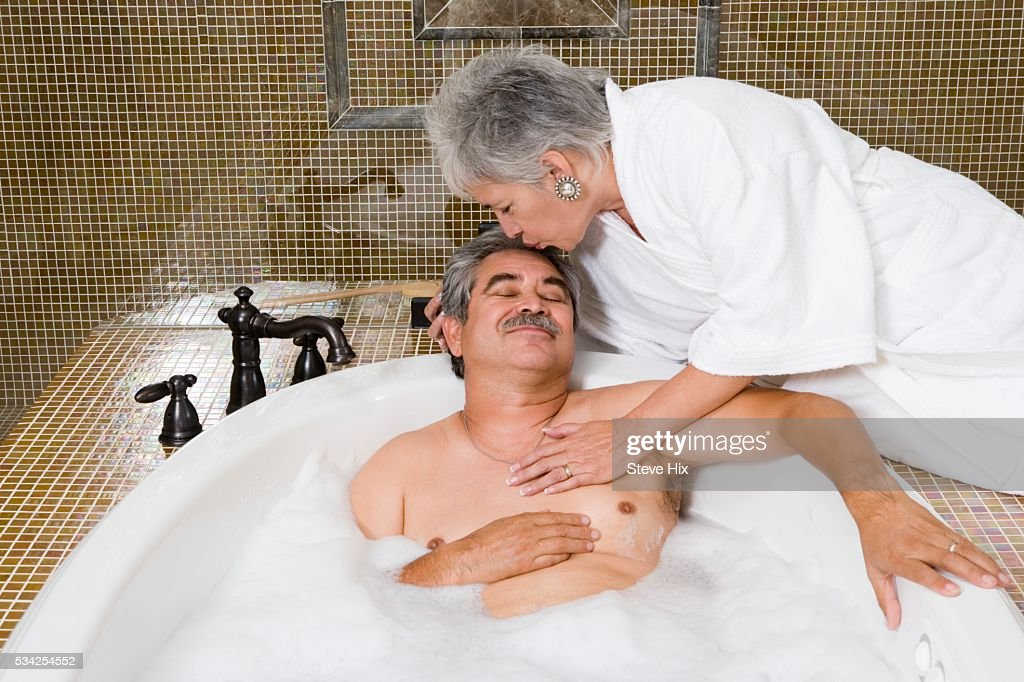 wife kissing husband in bath tub stock photo getty images