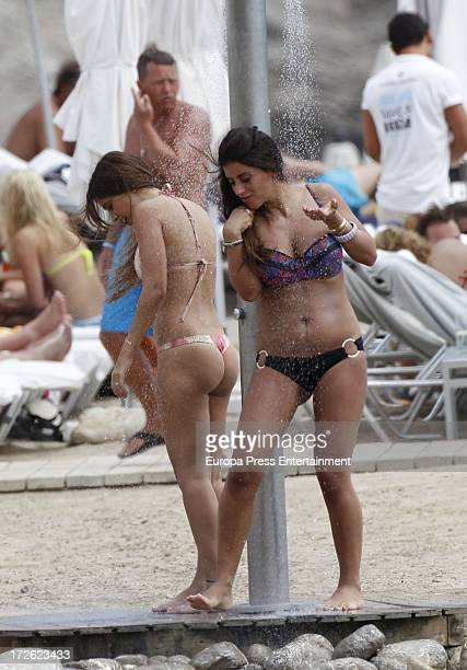 Wife of Cesc Fabregas Daniella Semaan and Antonella Roccuzzi girlfriend of Leo Messi are seen at the beach on July 4 2013 in Ibiza Spain