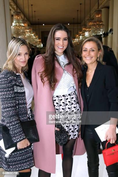 Wife of Doctor Frederic Saldmann Marie Saldmann Celia Jaunat and guest attend the Giambattista Valli show as part of the Paris Fashion Week...