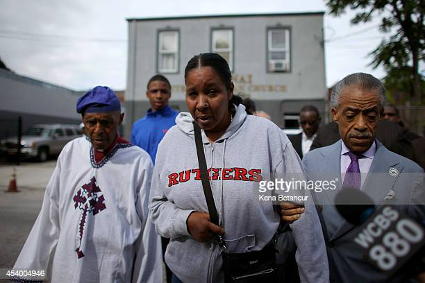 wife of Eric Garner next to Rev Herbert Daughtry left and Rev Al Sharpton arrive to attend a church service before a rally against police violence on...