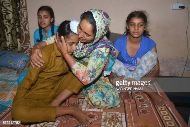 Wife of Indian army soldier Paramjeet Singh Paramjeet Kaur cries and holds her son Sahildeep Singh as she is flanked by her daughters Simrandeep Kaur...