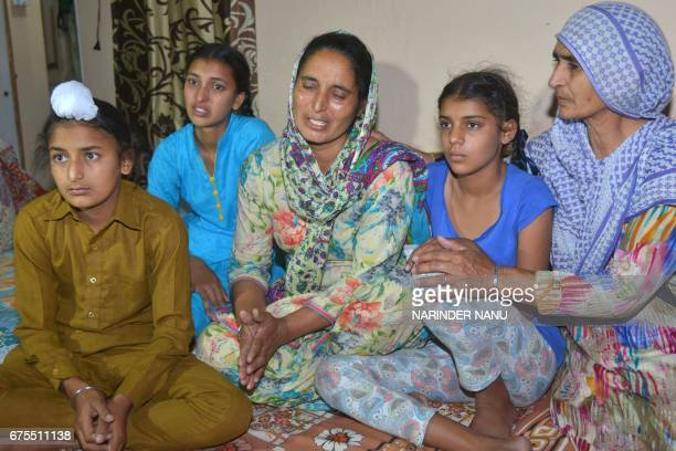 Wife of Indian army soldier Paramjeet Singh Paramjeet Kaur cries with her daughters Simrandeep Kaur and Khushdeep Kaur and son Sahildeep Singh at...