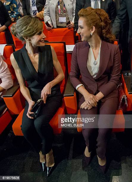 Wife of King Mohammed VI of Morocco Princess Lalla Salma speaks with Queen Letizia of Spain during the World Cancer Congress in Paris on October 31...