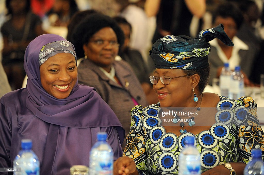 Wife of Nigerian Vice President Hajia Namadi Sambo (L) chats with Nigerian Finance Minister Ngozi Okonjo-Iweala during the opening of African Women Economic Summit held in Lagos on July 13, 2012. An NGO, New Faces New Voices (NFNV) in partnership with the African Development Bank, is hosting its second African Women Economic Summit (AWES) to discuss topics around the development of women in finance. AFP PHOTO/PIUS UTOMI EKPEI