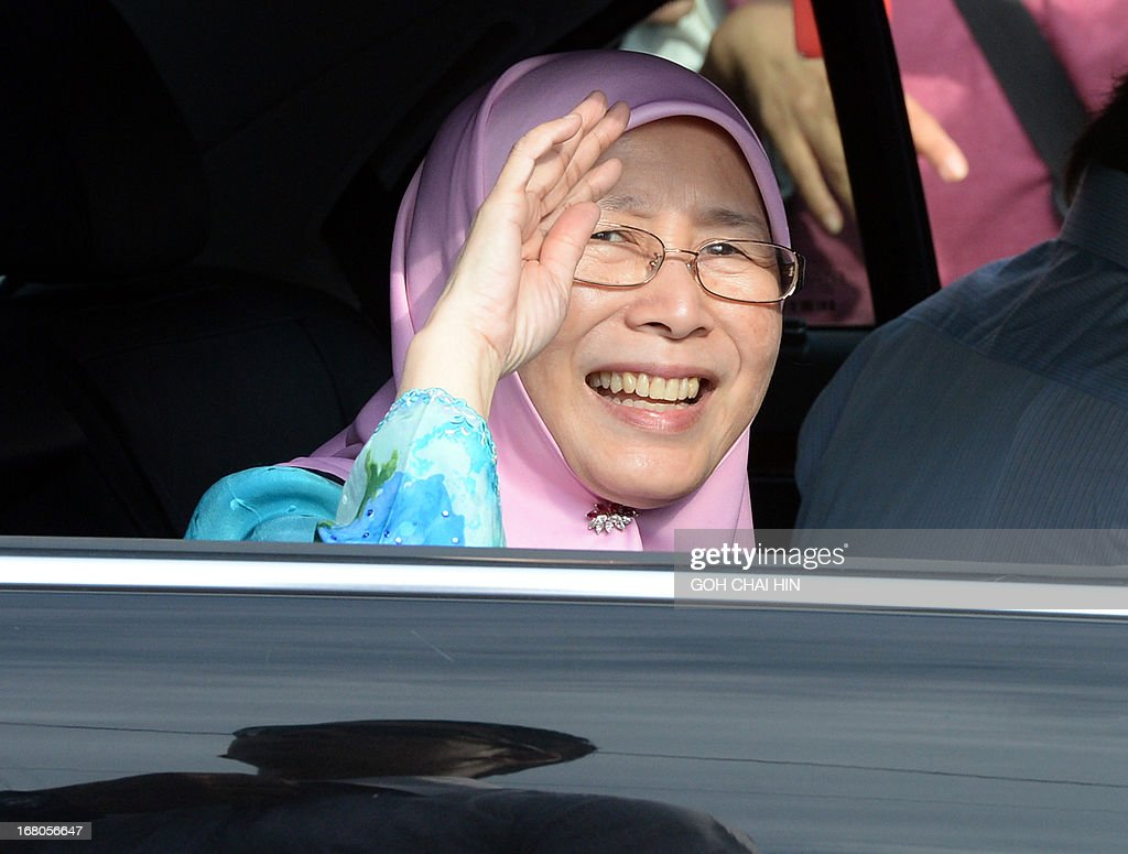 Wife of opposition leader Anwar Ibrahim, Wan Azizah waves from the car as she leaves the polling station after casting her vote at a polling station in Permatang Pauh, Penang on May 5, 2013. Malaysians voted in their first election in history with a change of government at stake, as a decades-old regime battles to hold off a rising opposition pledging sweeping reform.
