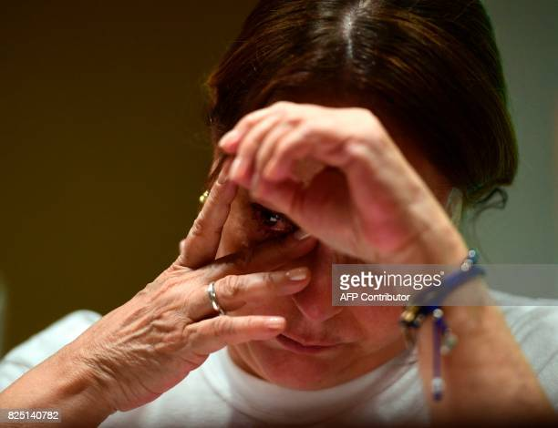 Wife of prominent opposition leader and mayor of Caracas Antonio Jose Ledezma Mitzy Capriles wipes her eye during a press conference in madrid on...