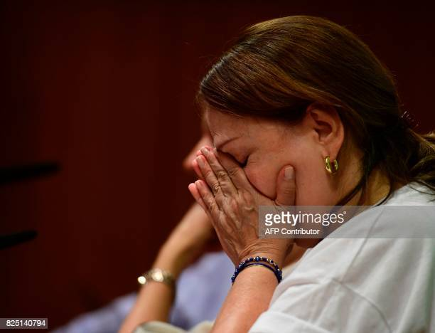 Wife of prominent opposition leader and mayor of Caracas Antonio Jose Ledezma Mitzy Capriles wipes her eyes during a press conference in madrid on...
