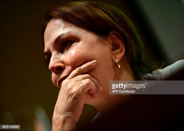 Wife of prominent opposition leader and mayor of Caracas Antonio Jose Ledezma Mitzy Capriles gestures during a press conference in madrid on August 1...