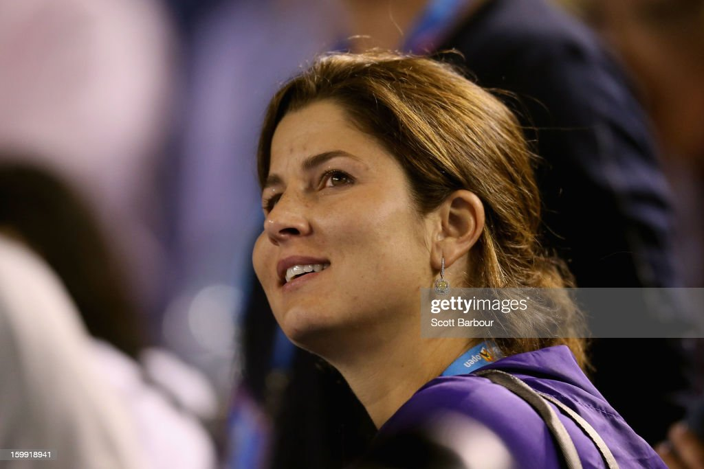 Wife of Roger Federer, Miroslava Vavrinec watches Jo-Wilfred Tsonga of France and Roger Federer of Switzerland in their Quarterfinal match during day ten of the 2013 Australian Open at Melbourne Park on January 23, 2013 in Melbourne, Australia.