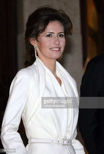Wife of Syrian President Bashar alAssad Asma arrives with her husband to attend the official launching ceremony of Damascus being named the 2008...