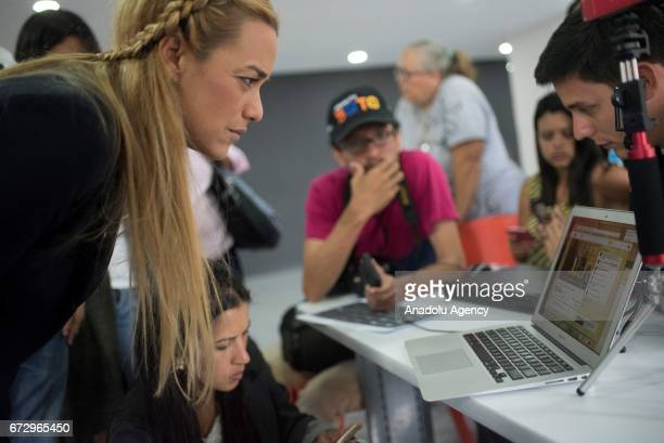 Wife of the Venezuelan opposition imprisoned political and activist Lilian Tintori watch a live press conference of the Venezuela's prosecutor Luisa...