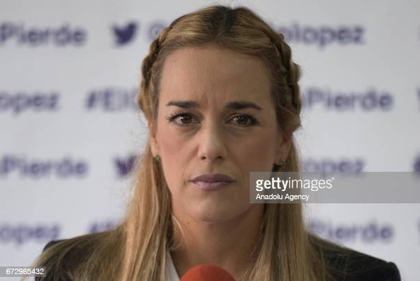 Wife of the Venezuelan opposition imprisoned political leader and activist Lilian Tintori cries during a press conference in Caracas Venezuela on...