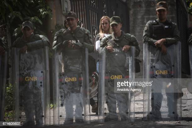 Wife of the Venezuelan opposition imprisoned political leader and activist Lilian Tintori waits behind a Ntional Guard Pickect to visit her husband...