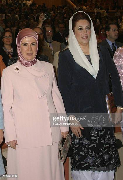 Wife of Turkish Prime Minister Recep Tayyip Erdogan Amina and former Pakistani premier Benazir Bhutto stand during the opening session of the Women...