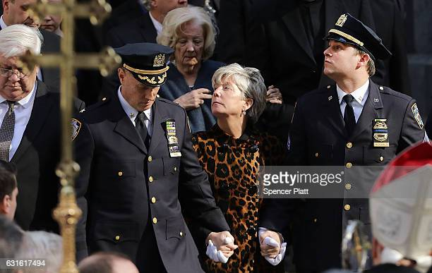 Wife Patricia Ann NorrisMcDonald and son Conor follow the casket of New York City police officer Steven McDonald at St Patrick's Cathedral during his...