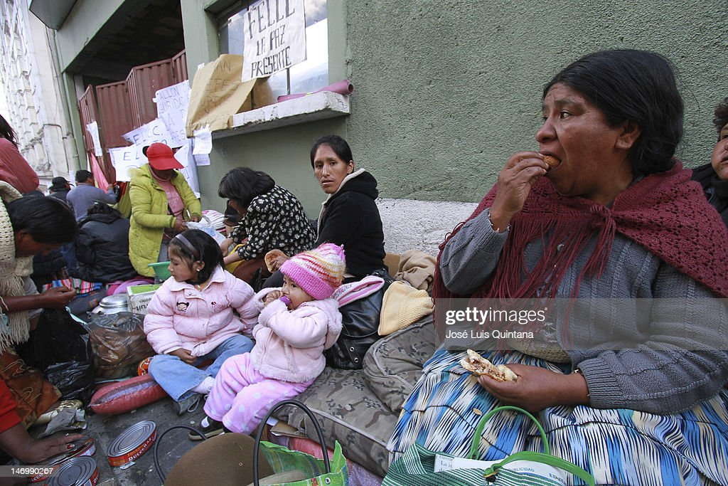 Wifes and kids of striking police took over the Police Operation Units, during the 4th day of police riot in protest of low pay, on June 24, 2012 in La Paz, Bolivia. They demand they pay be raised to equal that of soldiers of the same rank.