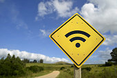 Internet access in remote zone, power of technology concept. Road sign with wifi signal icon on rural environment, includes copy space.