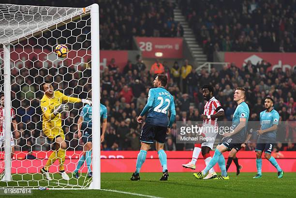 Wifried Bony of Stoke City scores their third goal past goalkeeper Lukasz Fabianski of Swansea City during the Premier League match between Stoke...