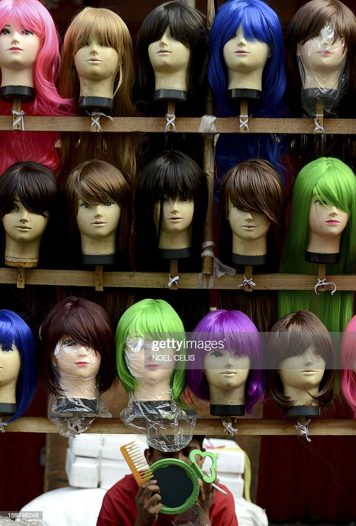 A wig vendor waits for customers at the Divisoria Market in Manila on January 20, 2013.