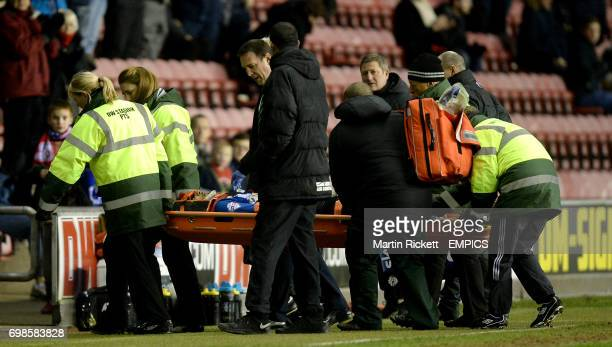 Wigan Atheltic's Leon Clarke leaves the pitch on a stretcher after an injury against Charlton Athletic