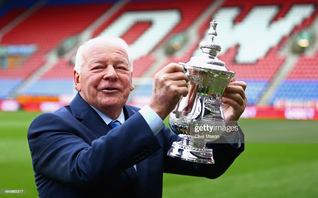 Wigan Athletic Chairman Dave Whelan holds the FA Cup prior to the Budweiser FA Cup fourth round match between Wigan Athletic and Crystal Palace at DW...