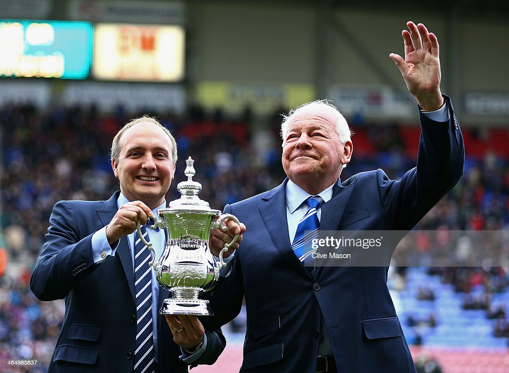 Wigan Athletic Chairman Dave Whelan (R) holds the FA Cup prior to the Budweiser FA Cup fourth round match between Wigan Athletic and Crystal Palace at DW Stadium on January 25, 2014 in Wigan, England.