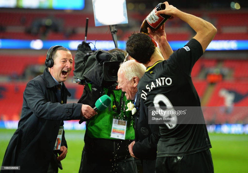 Wigan Athletic chairman Dave Whelan is showered in champagne by Franco Di Santo as they celebrate following their team's 1-0 victory during the FA Cup with Budweiser Final between Manchester City and Wigan Athletic at Wembley Stadium on May 11, 2013 in London, England.