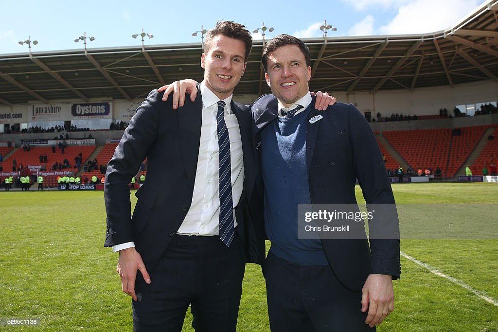 Wigan Athletic chairman David Sharpe and manager Gary Caldwell celebrate promotion to the Championship after the Sky Bet League One match between Blackpool and Wigan Athletic at Bloomfield Road on April 30, 2016 in Blackpool, England.
