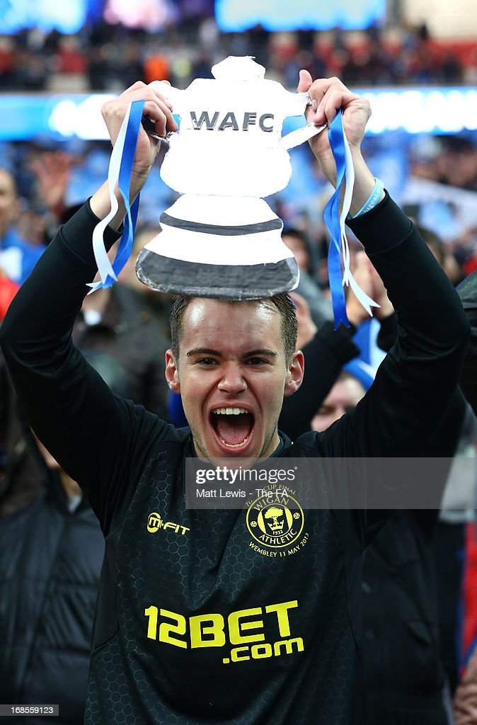 A Wigan Athletic fan celebrates after victory in the FA Cup with Budweiser Final match between Manchester City and Wigan Athletic at Wembley Stadium on May 11, 2013 in London, England.