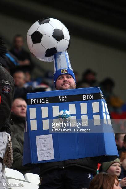 A Wigan Athletic fan dressed as the tardis from Doctor Who